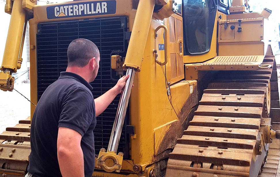 Pieter Quaegebeur inspects Better Globe Forestry's new Caterpillar bulldozer