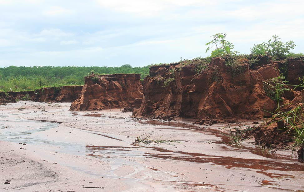 Erosion of soil caused by heavy rainfall