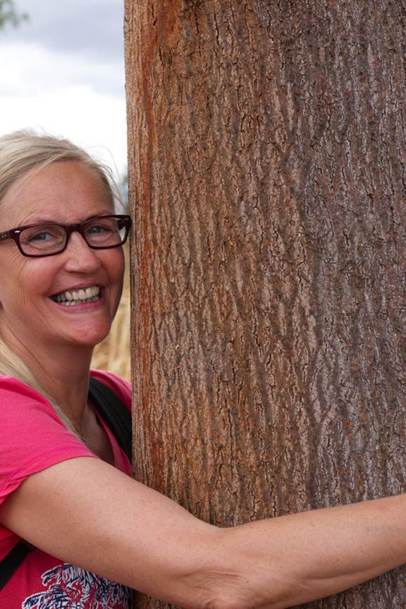 Tina Bjerke hugging a 20-year old mukau tree