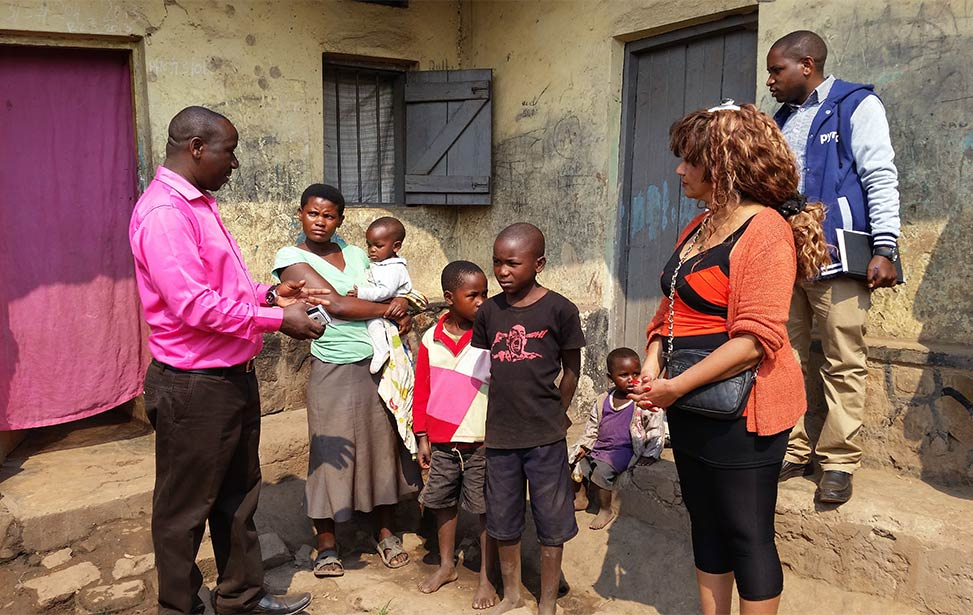 Julie Solberg visiting the homes of Child Africa students