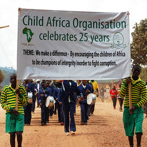 Child Africa celebrating 25 years of operation, marching through Kabale town