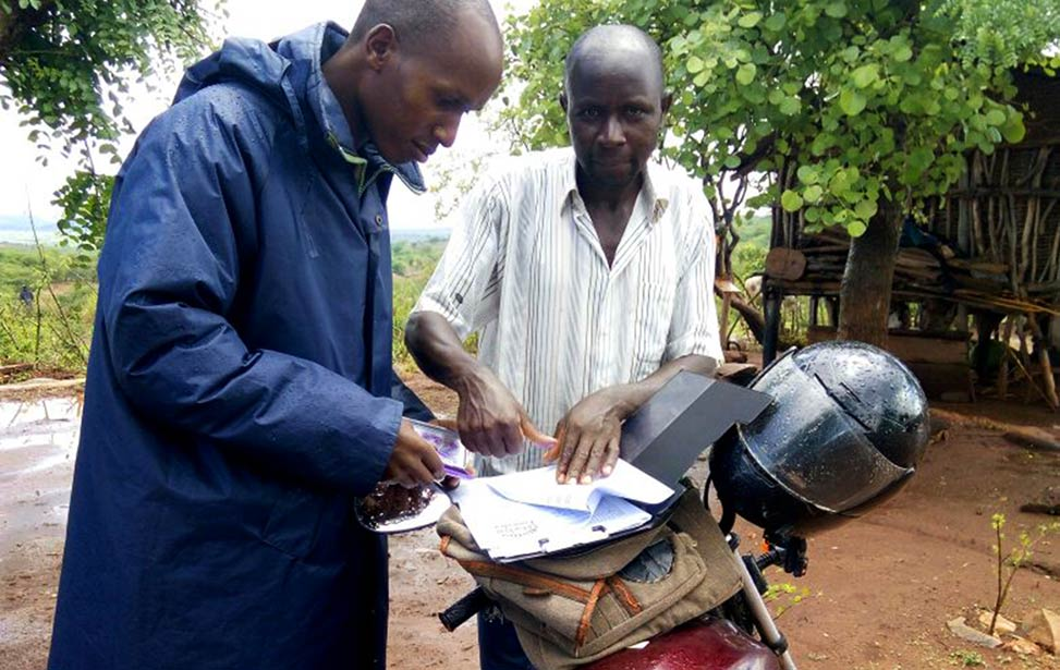 A new farmer signing up for our contract farmer program